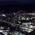 京都駅を発車した新幹線(京都タワーより)